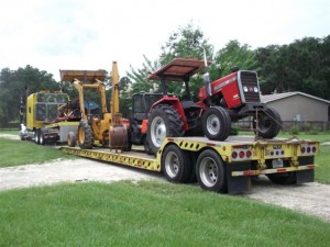 The final load arrived in mid-July...finally our backhoe, tractor, Kubota 4 x 4 and bushhog...now we were farmers again!